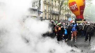 Members of French trade union CGT resume marching after a halt due to clashes between protesters and police during the annual May Day rally in Paris on May 1, 2021.