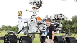 Thirteen-year-old Alex Mather, who won a national competition to name NASA's latest rover Perseverance, speaks to the media in front of a mock-up of the robot at Cape Canaveral Air Force Station in Florida