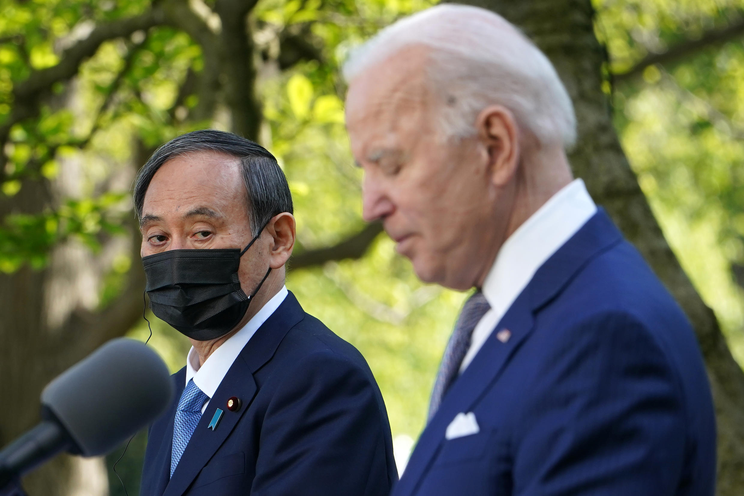 US President Joe Biden speaks at a joint news conference with Japan's Prime Minister Yoshihide Suga