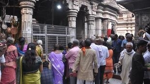 Hindus with heads shaved after a cremation in Varanasi visits temple as part of a purification process.