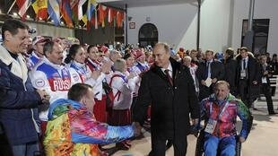 Russian President Vladimir Putin (C) visits the mountain Paralympic village on the eve of the opening of the 2014 Sochi Paralympic Winter Games