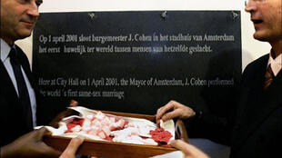 Amsterdam's mayor unveils a plaque commemorating the city's first gay marriage