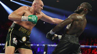 Tyson Fury punches Deontay Wilder during their heavyweight bout for Wilder's WBC belt in February 2020 at MGM Grand Garden Arena in Las Vegas, Nevada