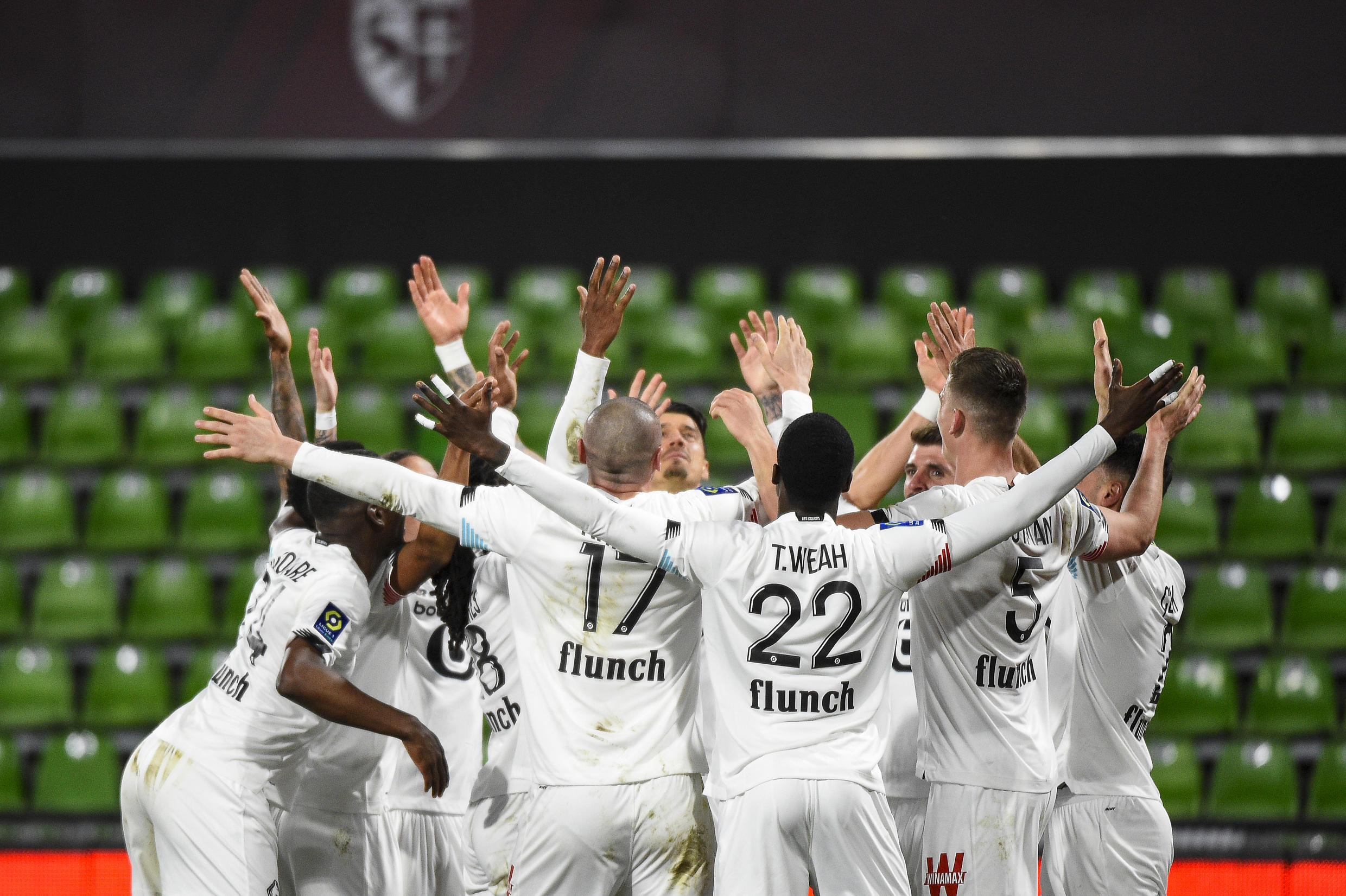 Lille players celebrate after climbing sx points clear in Ligue 1