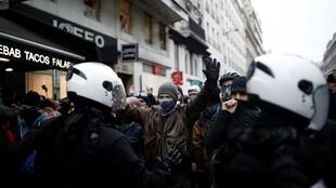 Masked protestors face off with French police during a demonstration against French government's pensions reform plans in Paris as part of the 36th consecutive day of strike in France, January 9, 2020.