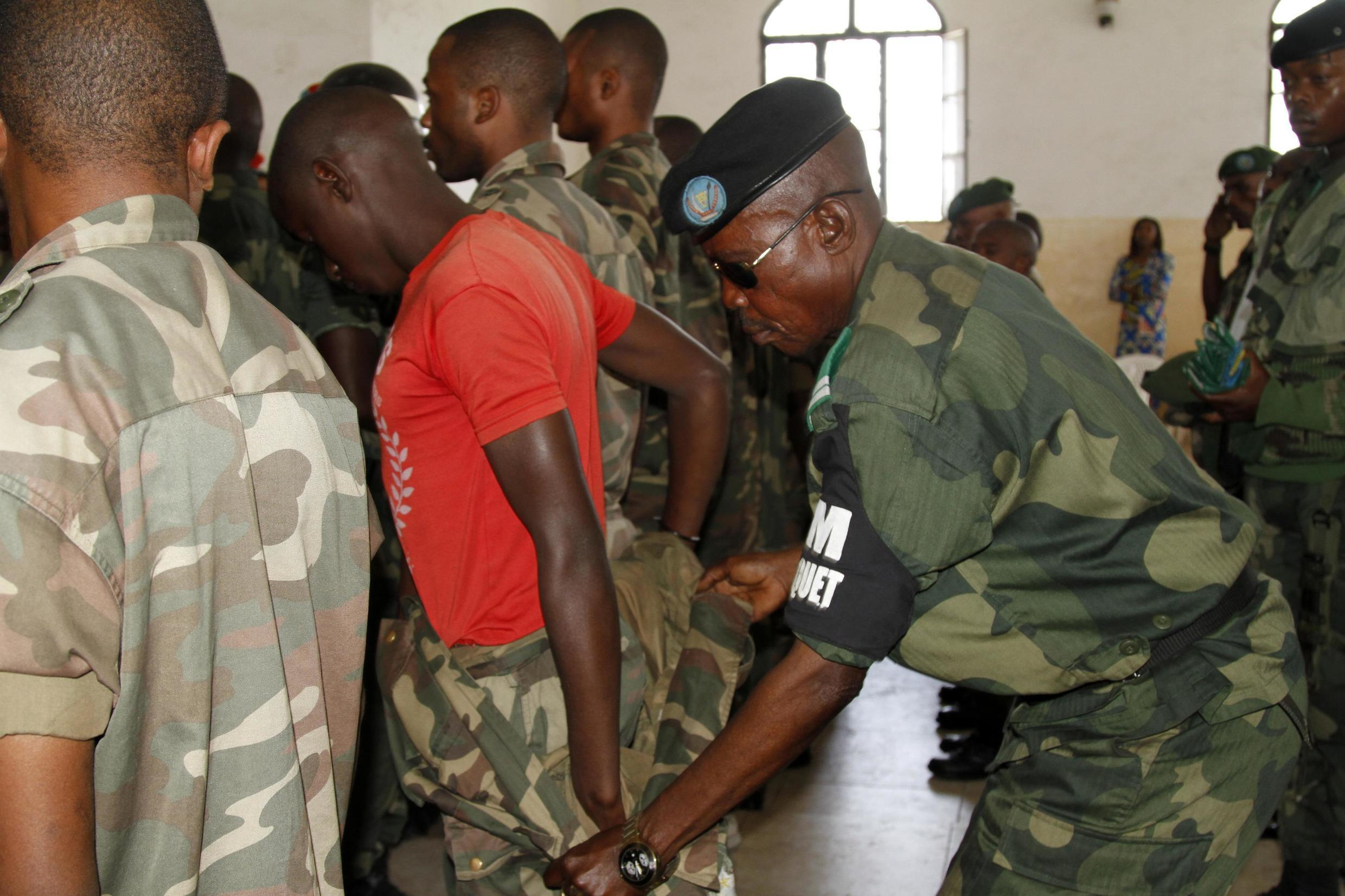 Congolese soldier stripped of his rank and uniform after the mass trial of 39 soldiers,  Goma, DRC, 5 may 2014.