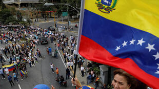 Des militants de l'opposition défilent dans les rues de Caracas le 30 janvier 2019.