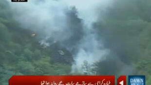 Thick smoke from the plane crash as seen on Pakistani television station Dawn
