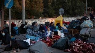 Some of the thousands of people left homeless after fire ravaged the Moria refugee camp on the Greek island of  Lesbos.