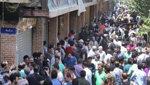 اعتراضهای بازار تهران به شرایط بحرانی اقتصادی و نوسانات بهای ارز در ایران