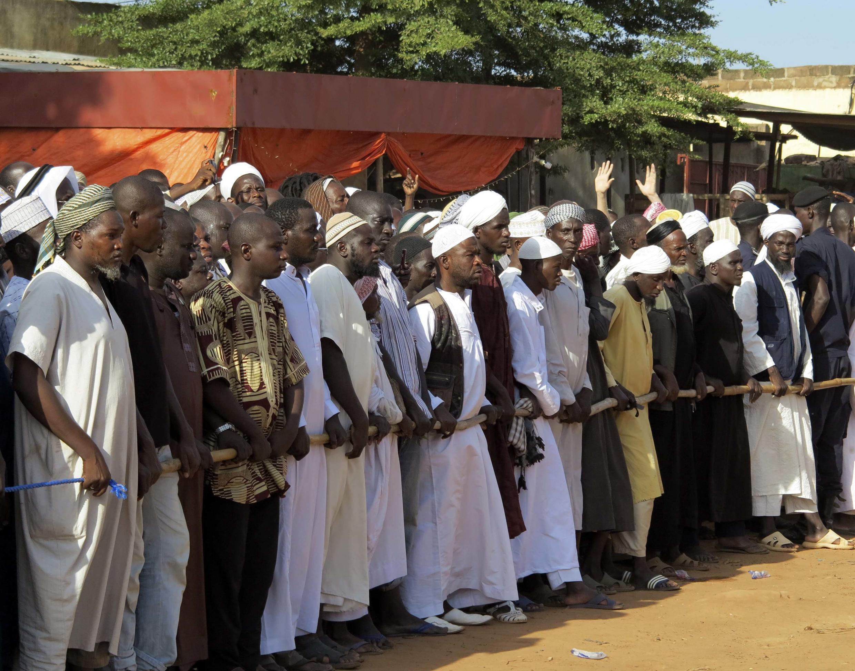 Funérailles d'une partie des victimes de la secte Dawa, le 14 septembre 2012.