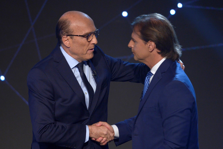 Os candidatos à presidência do Uruguai, Daniel Martinez, da Frente Ampla, e Luis Lacalle Pou, do Partido Nacional.