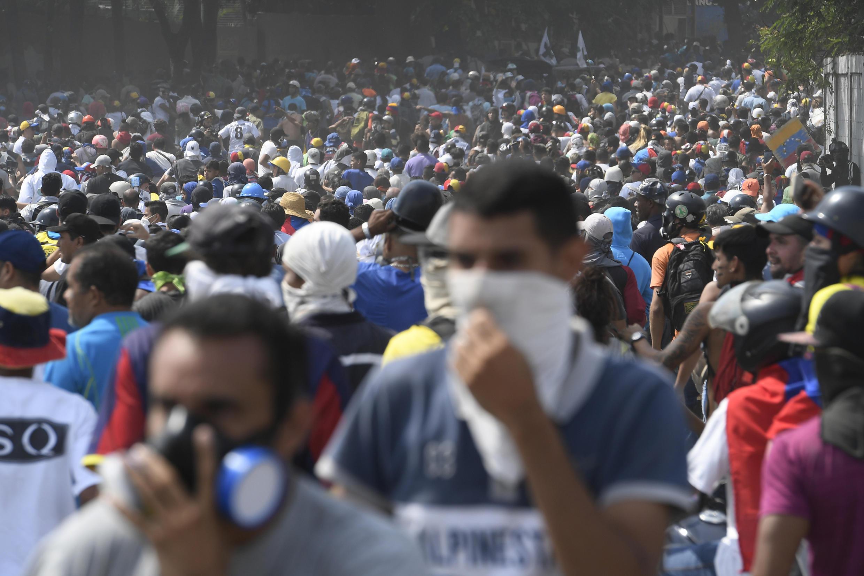 Les partisans de l'opposant Juan Guaido défilent, à Caracas, le 1er mai 2019.