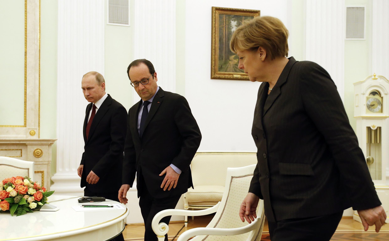 Президент России Владимир Путин, президент Франции Франсуа Олланд и канцлер Германии Ангела Меркель на переговорах в Москве, 6 февраля 2015 г.