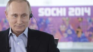 Vladimir Putin durante entrevista na televisão neste domingo, 19 de janeiro de 2014.