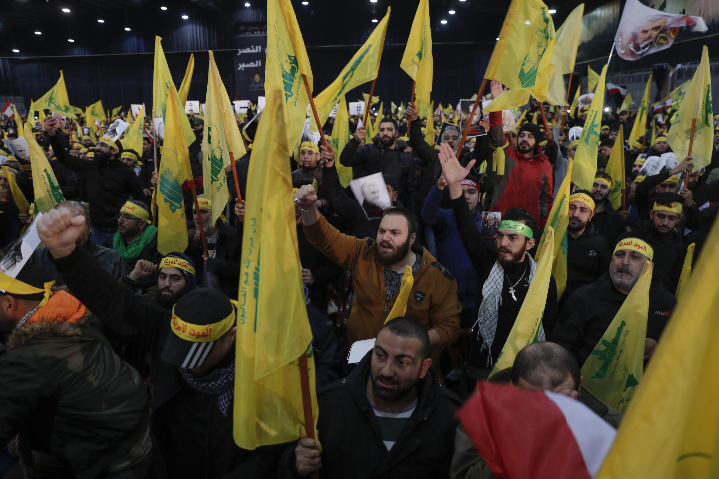 Hezbollah supporters wave flags in the suburbs of Beirut on January 5, 2020. Muhammad Kawtharani is a senior leader in the Lebanese Shiite movement, the US says