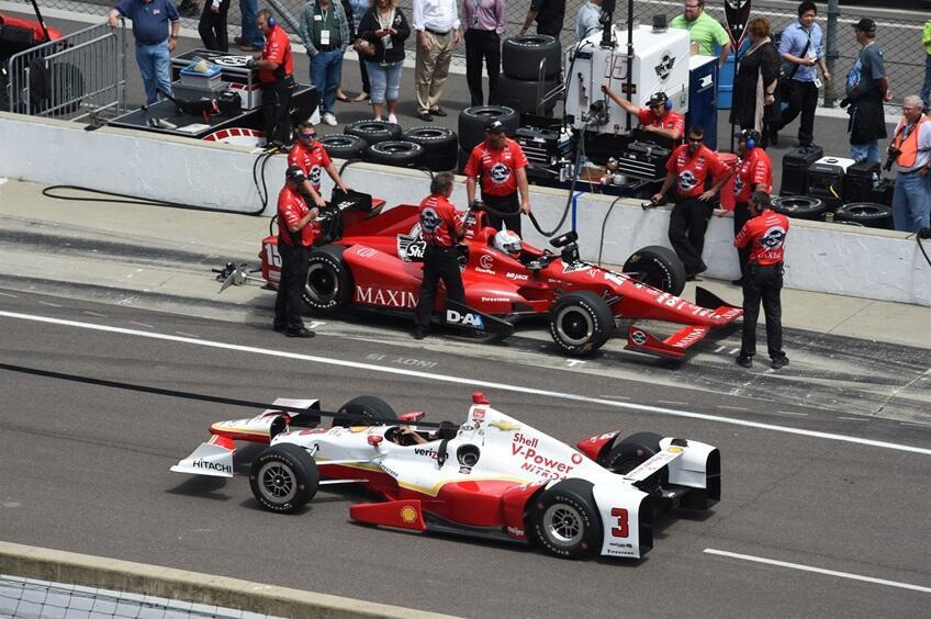 Helio Castroneves and Graham Rahal prepare for practice at the Indianapolis Motor Speedway, 14 May 2015