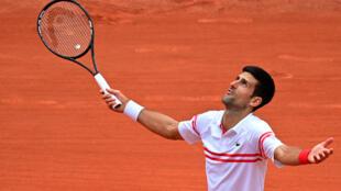 Le Serbe Novak Djokovic après sa victoire contre l'Italien Lorenzo Musetti, le 7 juin 2021 à Roland-Garros
