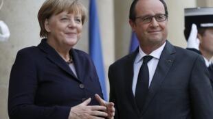 Thủ tướng Đức Angela Merkel và tổng thống Pháp François Hollande tại Paris. Ảnh chụp ngày 27/10/2015.