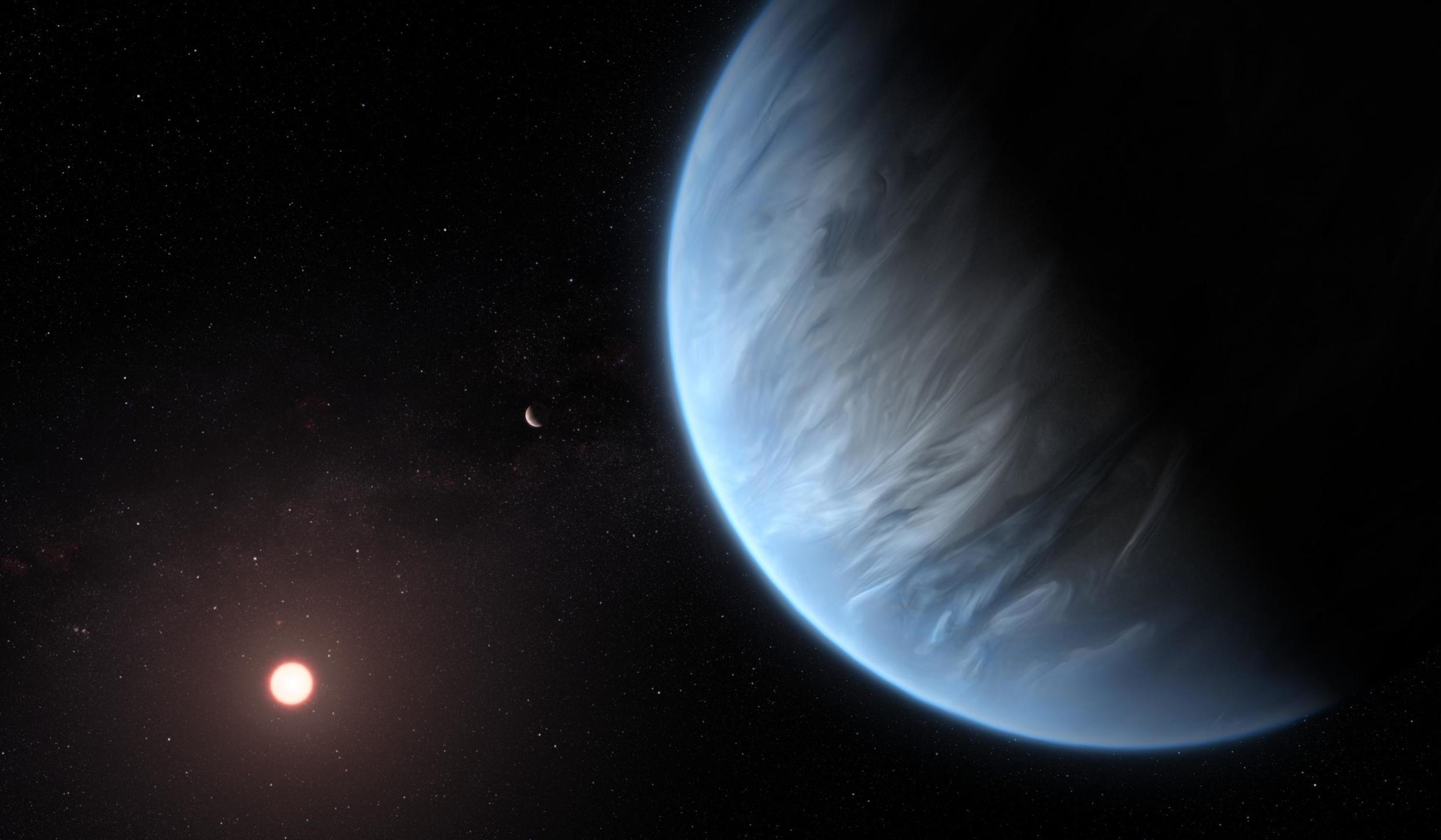 This artist's impression shows the planet K2-18b, its host star and an accompanying planet in this system. K2-18b is now the only super-Earth exoplanet known to host both water and temperatures that could support life.