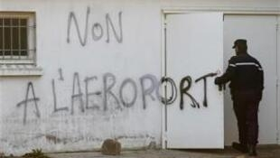 Tag on a wall in Notre Dame-Des-Landes where the new airport is going to be built