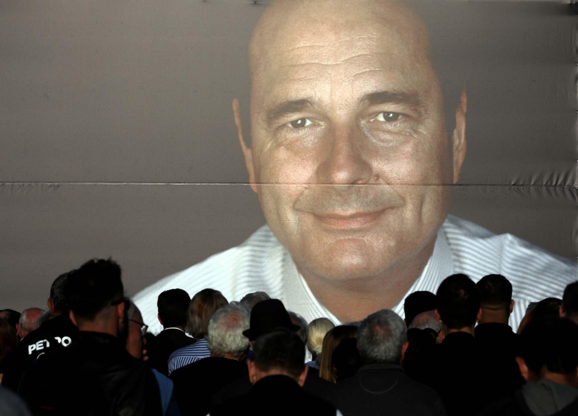 People gather to pay tribute to late former French President Jacques Chirac in Nice, France, September 27, 2019.