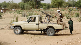Sudanese security forces patrol in al-Geneina, West Darfur