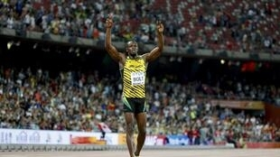 Ямайский спринтер Усейн Болт выиграл стометровку на чемпионате мира в Пекине, 23 августа 2015 г.