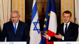 Firaministan Isra'ila Benjanmin Netanyahu tare da shugaban Faransa Emmanuel Macron