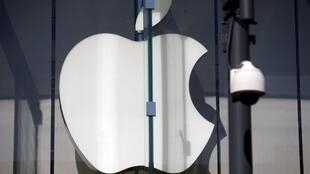 The logo of Dow Jones Industrial Average stock market index listed company Apple (AAPL) is seen next to a security camera in Santa Monica, California, United States, April 12, 2016.