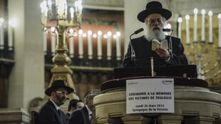 A ceremony paying tribute to the victims of Toulouse killer Mohammed Merah in a Paris synagogue last year