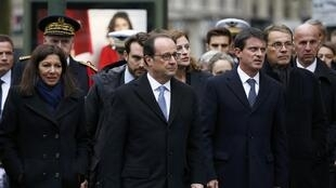President Francois Hollande, Prime Minister Manuel Valls and Paris Mayor Anne Hidalgo arrive at Paris' 11th district town hall on November 13, 2016, during a ceremony held for the victims of last year's attacks.