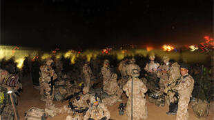 British soldiers from the First Battalion The Royal Welsh mobilise for Operation Moshtarak at Camp Bastion on Saturday