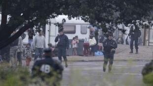 Police clear a Roma camp in Villeneuve d'Ascq on Thursday