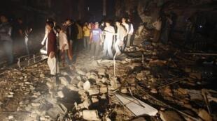 Sur les lieux de l'attentat, le 3 mars 2013, à Karachi.