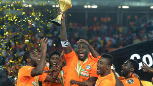 Ivory Coast's midfielder Yaya Toure (C) raising the trophy at the end of the 2015 African Cup of Nations final football match between Ivory Coast and Ghana in Bata on February 8, 2015.