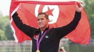 Oussama Mellouli, champion olympique du 10 kilomètres en eau libre à Londres.