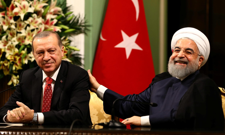 Turkish President Recep Tayyip Erdogan and Iranian President Hassan Rouhani in Tehran, 4 October 2017.