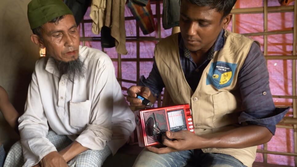 Abdallah, a Rohingya reporter with Radio Naf, playing programmes for Rohingya refugees in Kutupalong camp in Bangladesh