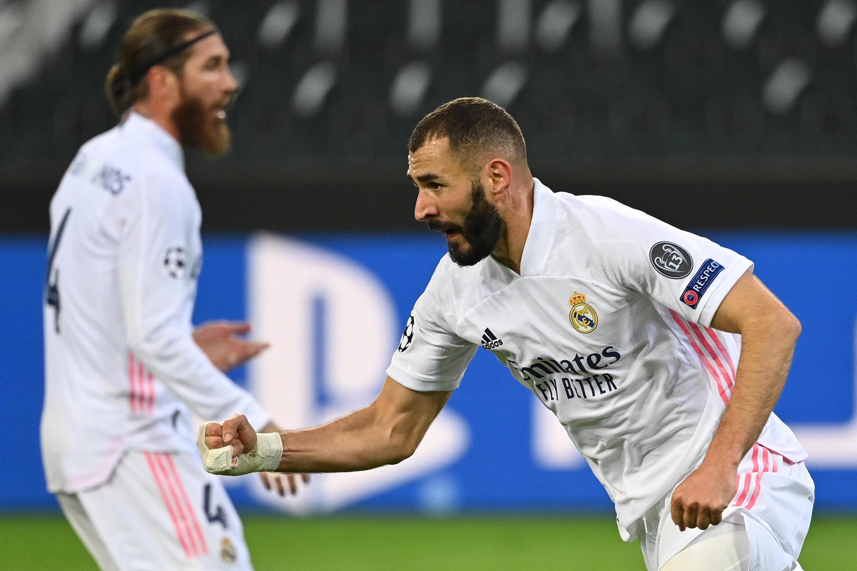 Sergio Ramos (esquerda), defesa espanhol do Real Madrid, e Karim Benzema (direita), avançado francês dos 'merengues', alcançaram um empate a duas bolas frente ao Borussia Mönchengladbach.