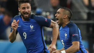 Dimitri Payet (right) celebrates with Olivier Giroud after scoring France's second goal against Romania.