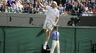 Sam Querrey celebrates after beating world number one Novak Djokovic in the third round of Wimbledon on Saturday.