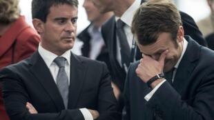 O primerio ministro, Manuel Valls, e o ministro da Economia, Emmanuel Macron.