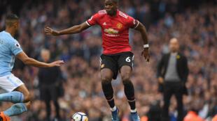 Dan wasan Faransa da ke taka leda a Manchester United Paul Pogba.
