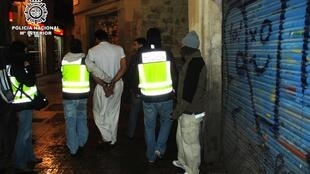 Six Pakistani men after they were arrested in Barcelona in connection to large al-Qaeda cell