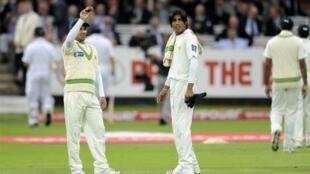 Pakistan's captain Salman Butt with player Mohammad Amir