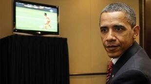 US President Barack Obama watches Ghana defeat his country's side on TV