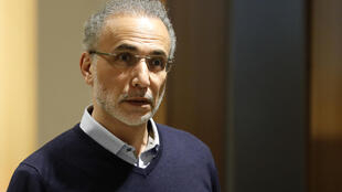 Swiss leading Islamic scholar Tariq Ramadan gestures next to AFP jounalist as he arrives at the Palais de Justice (Law Court) of Paris, on February 13, 2020