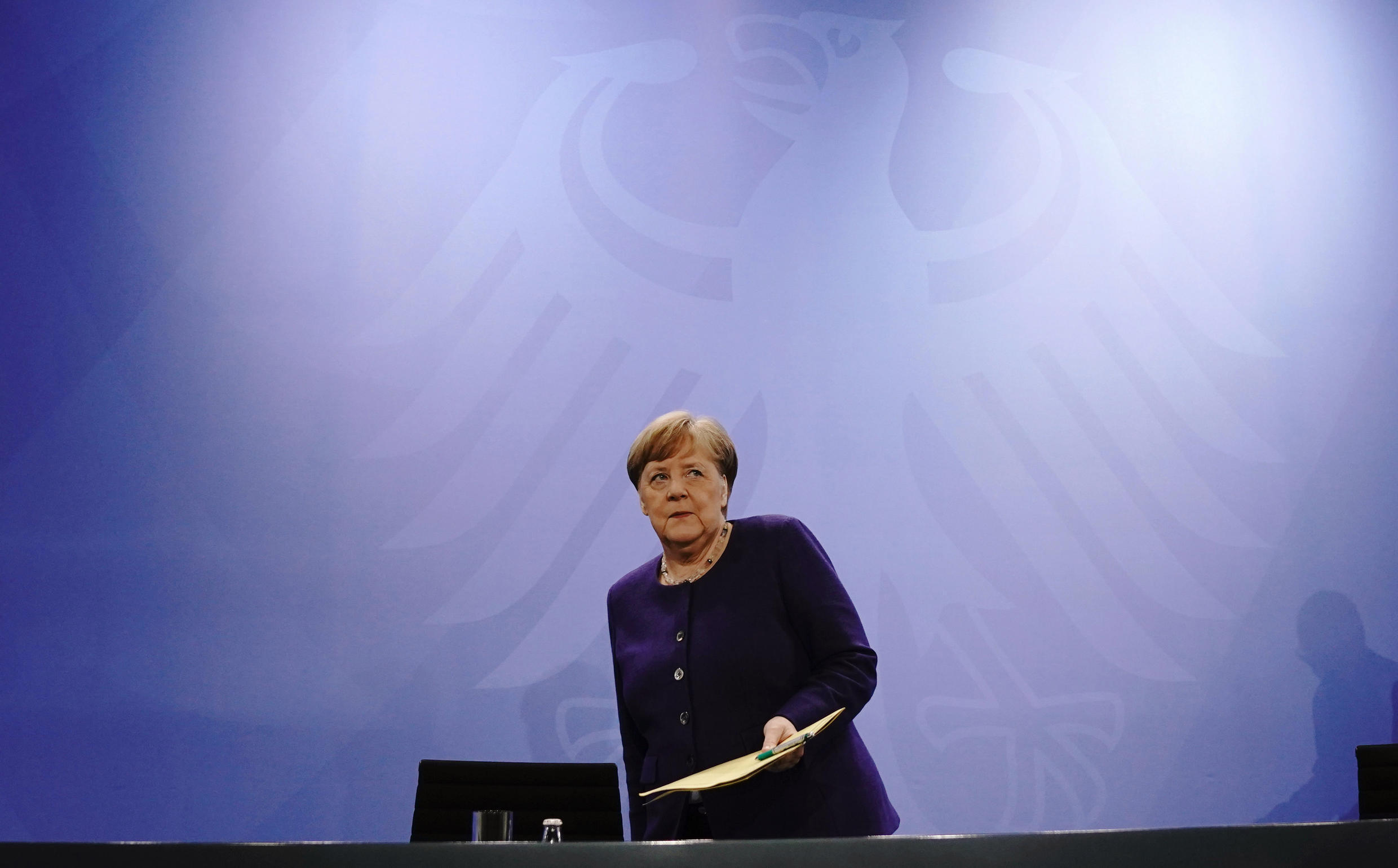 """After a meeting with state premiers, German Chancellor Angela Merkel said the relaxing of measures was just a """"step"""", with a more far-reaching plan to be agreed"""