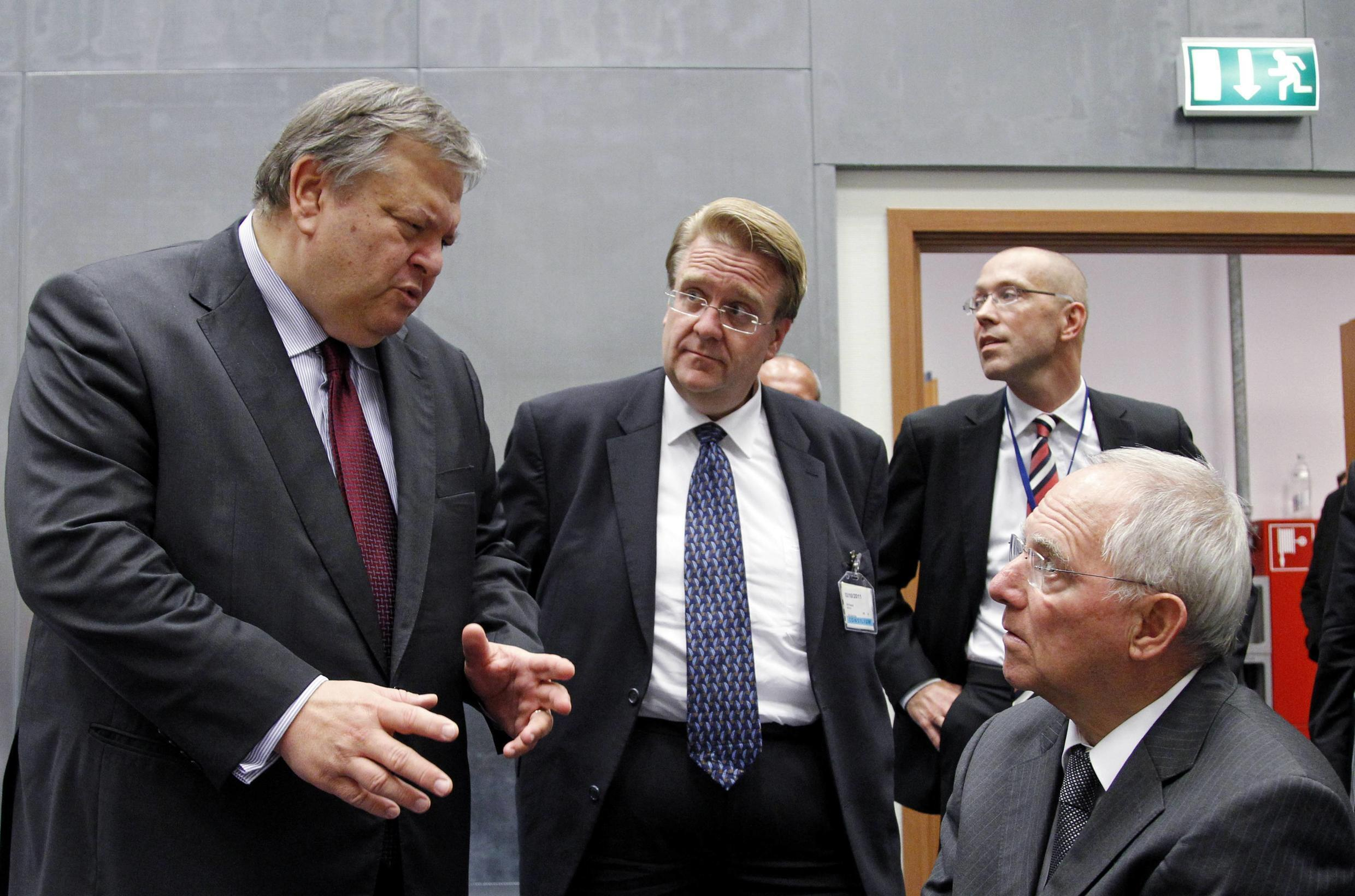 Greece's Finance Minister Evangelos Venizelos and his German counterpart Wolfgang Schaeuble